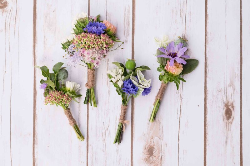 Buttonholes with a touch of blue